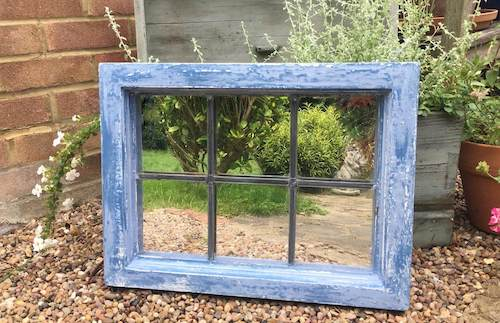 upcycled window frame turned into garden mirror